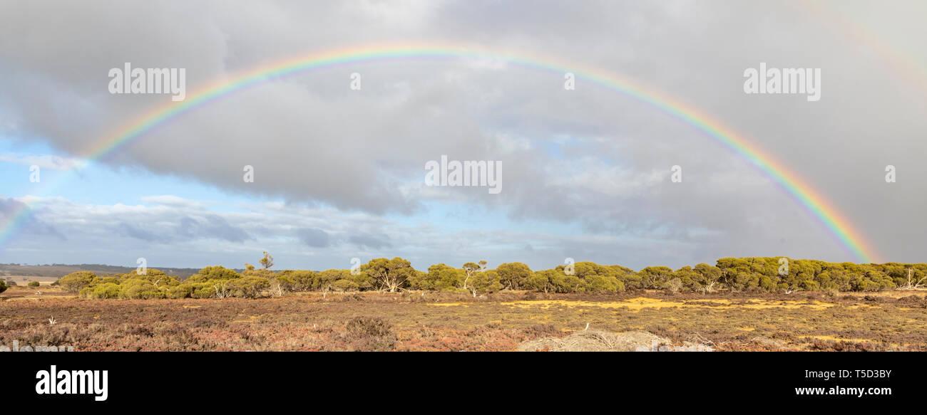 Rainbow viewed from Hog Bay Road, Kangaroo Island, South Australia - Stock Image
