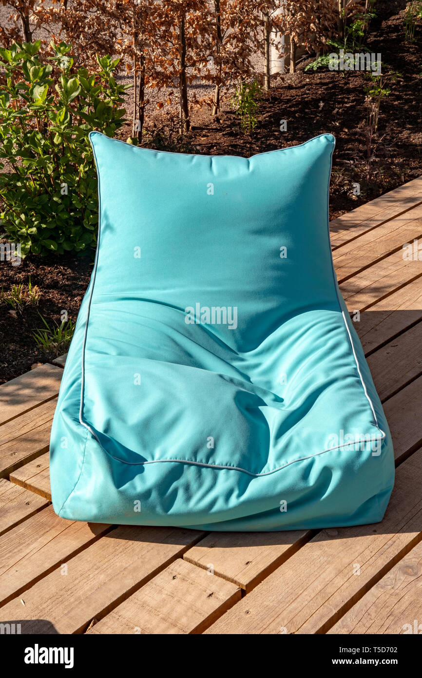 petrol colored beanbag comfortable and crumpled - Stock Image