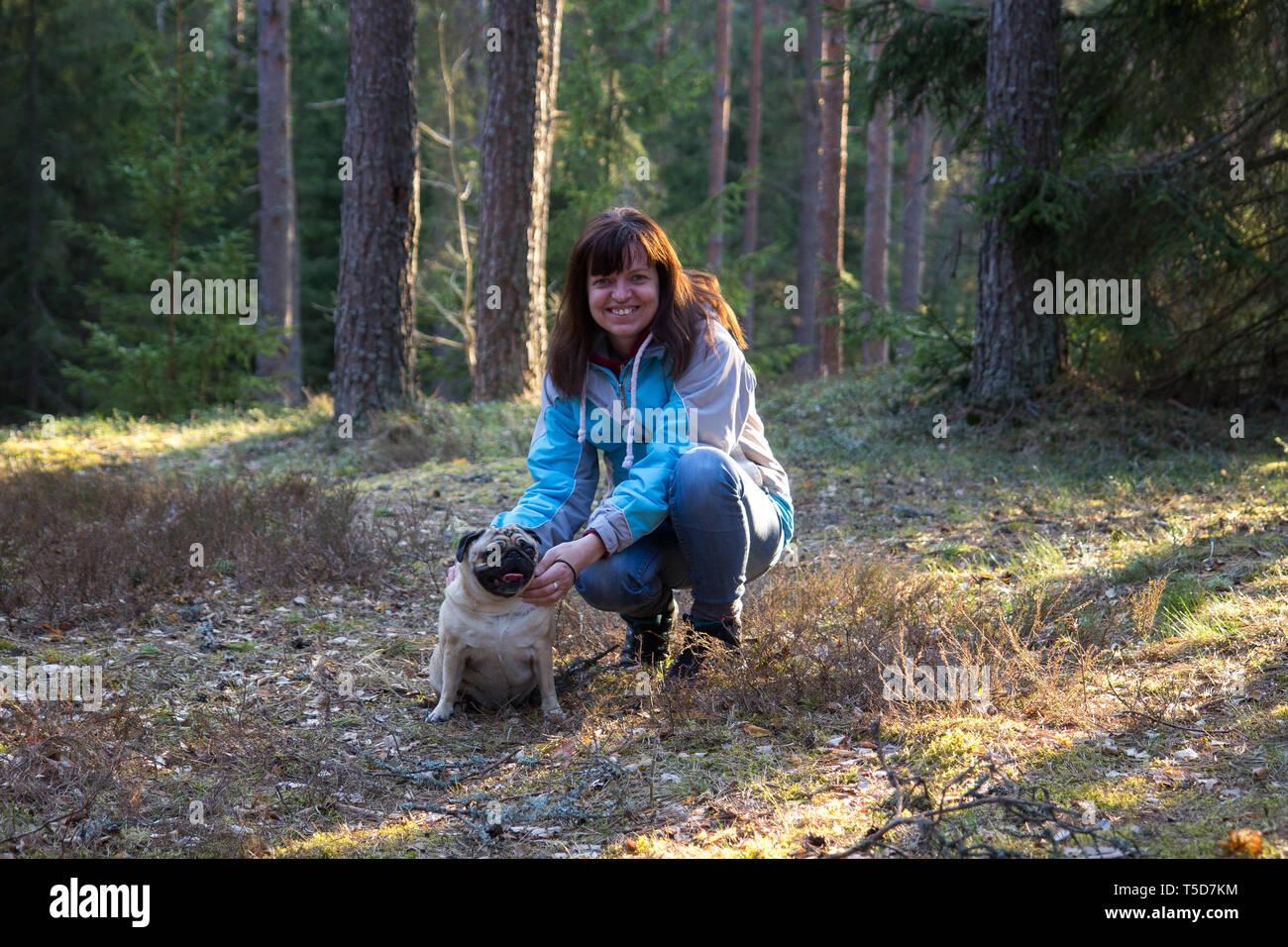 Woman with pug dog - Stock Image
