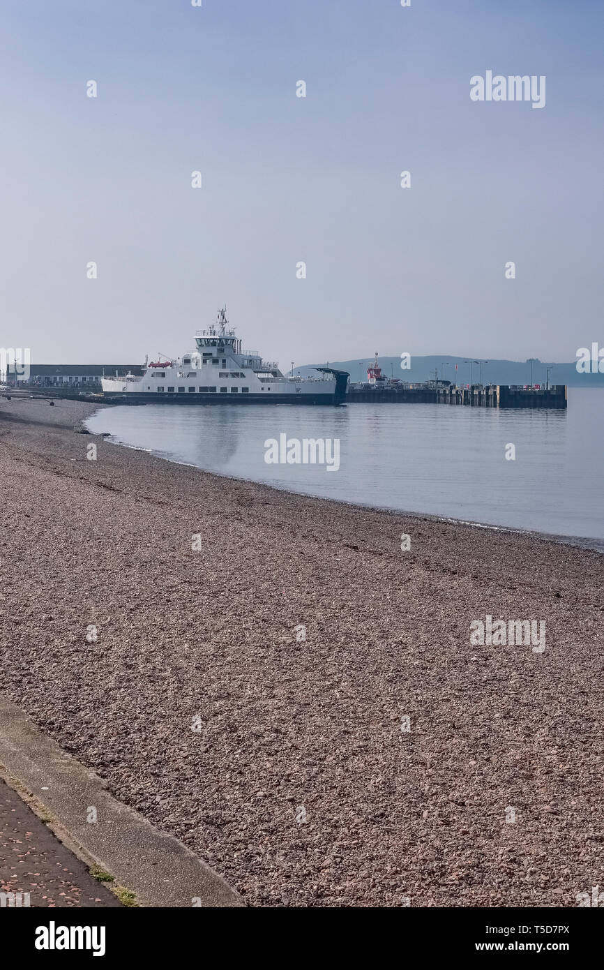 Largs Pier and the Cal-Mac ferry on an unusually warm day for the Easter weekend in Scotland. - Stock Image