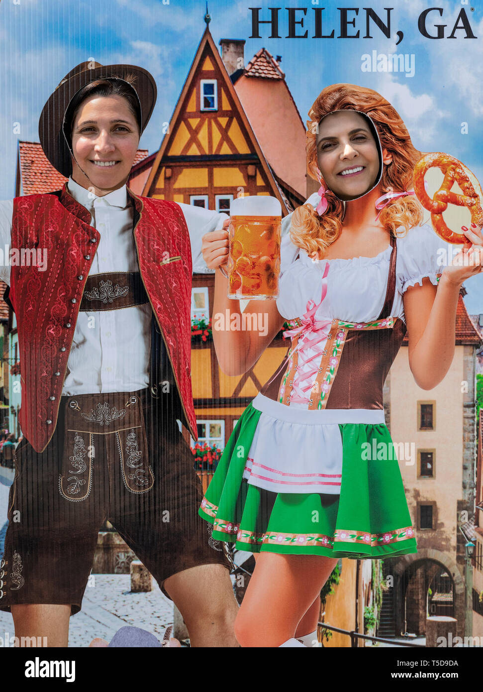 Tourists pose in German Octoberfest motif cut-out, Helen, Georgia, USA. - Stock Image