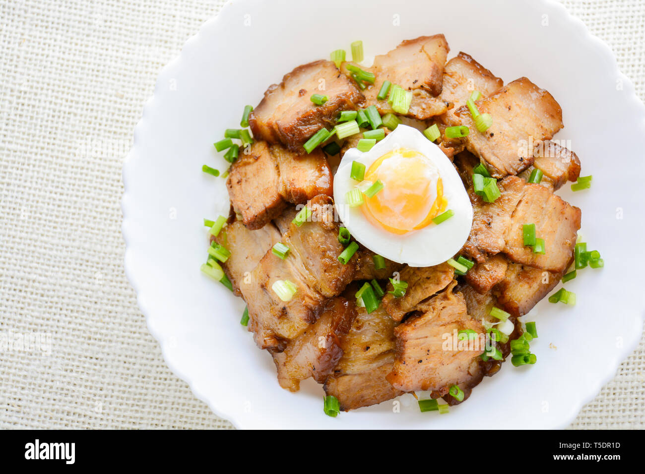 Bowl of rice topped with Braised pork belly and boiled egg, Japanese called Kakuni-don - Stock Image