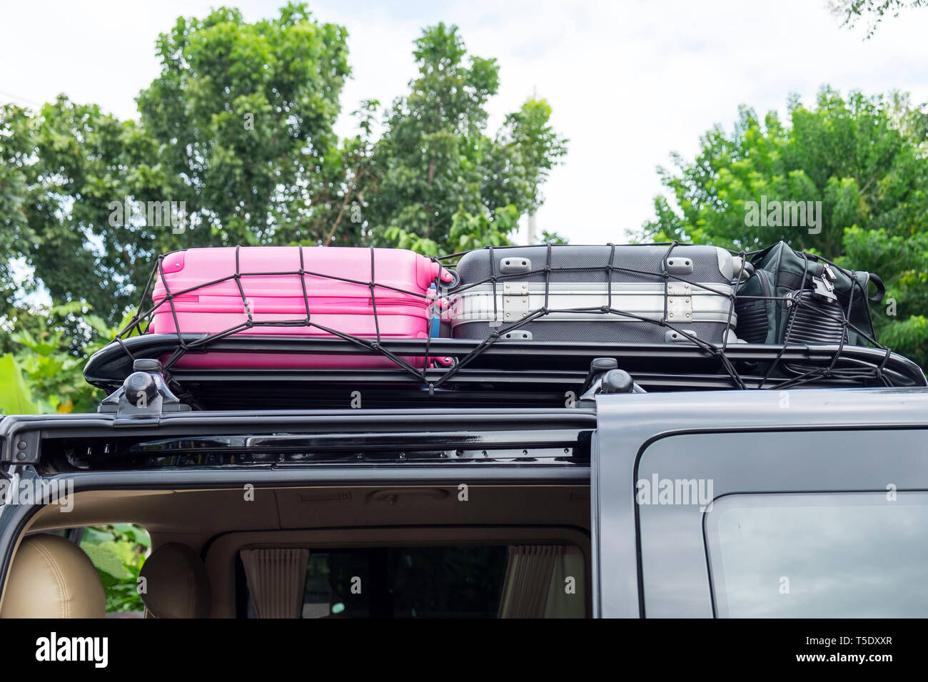 Rack on the roof van color luggage stack - Stock Image