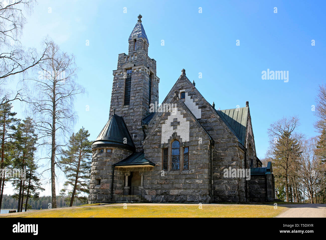 Karuna Church and bell tower in Karuna, Sauvo, South of Finland in spring.The church was built in 1908-10 in the style of Finnish National Romanticism - Stock Image