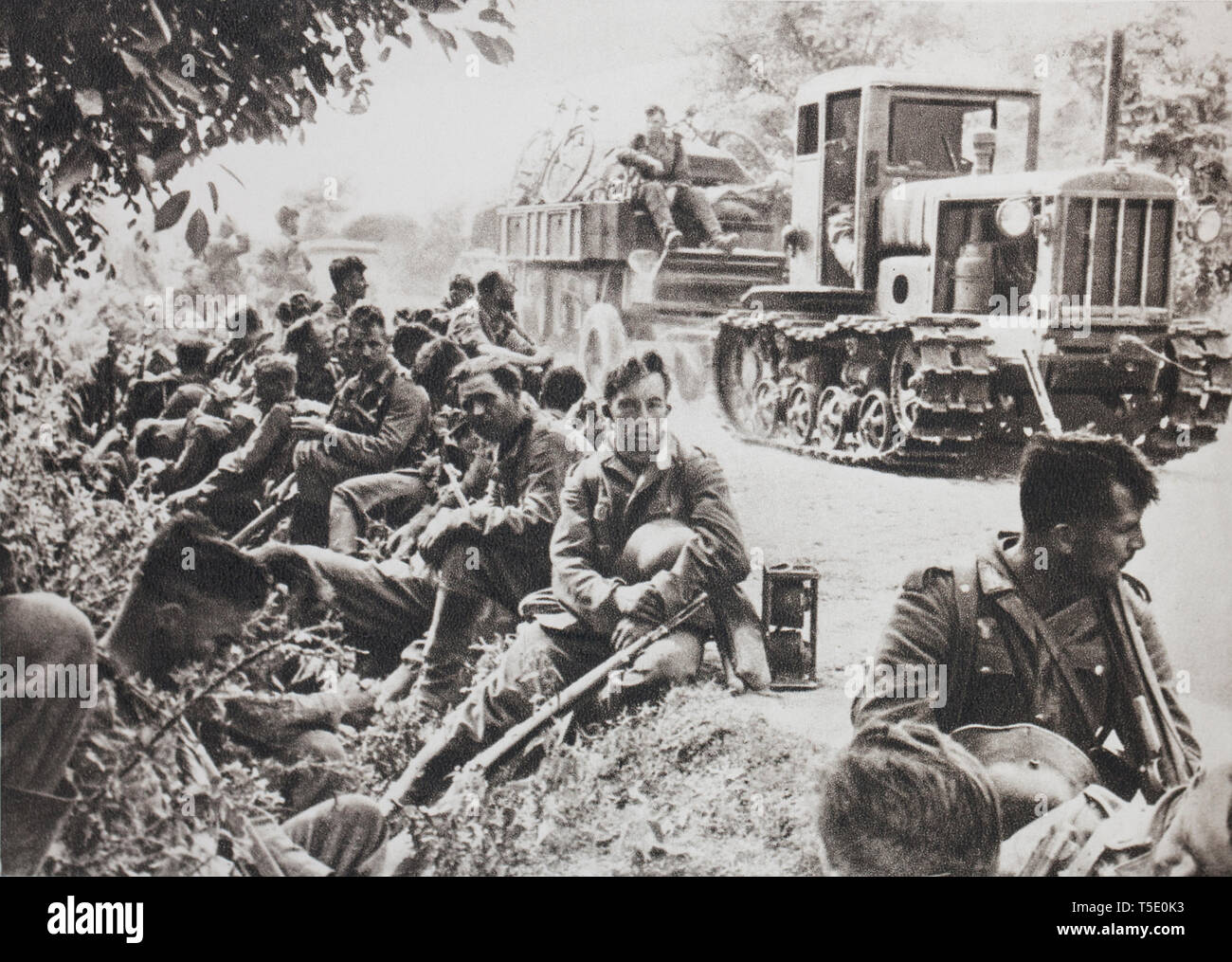 German infantry at rest on a road from Ukraine (1941). It meets in front of it only a country mercilessly damaged by the Russians. - Stock Image