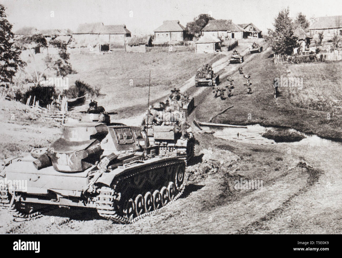 German troops on the East Front (summer 1941). A column of tanks pushes a pin of recognition. The German High Command has long anticipated victory, th - Stock Image