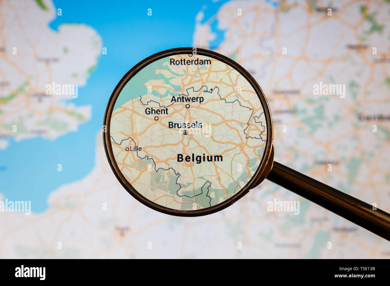 Brussels, Belgium. Political map. City visualization illustrative concept on display screen through magnifying glass. - Stock Image