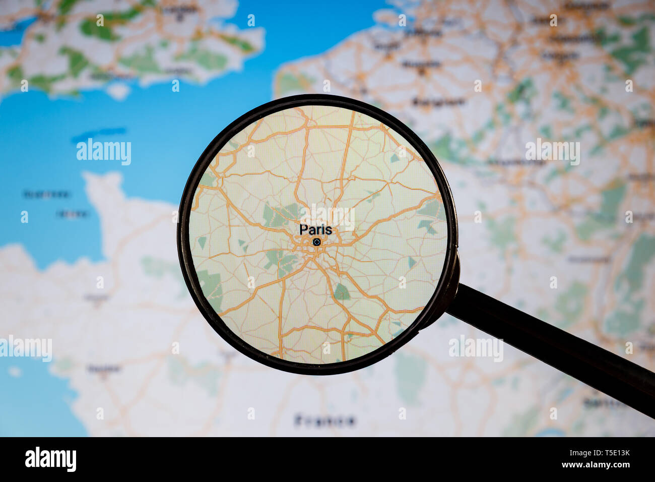 Paris, France. Political map. City visualization illustrative concept on display screen through magnifying glass. - Stock Image