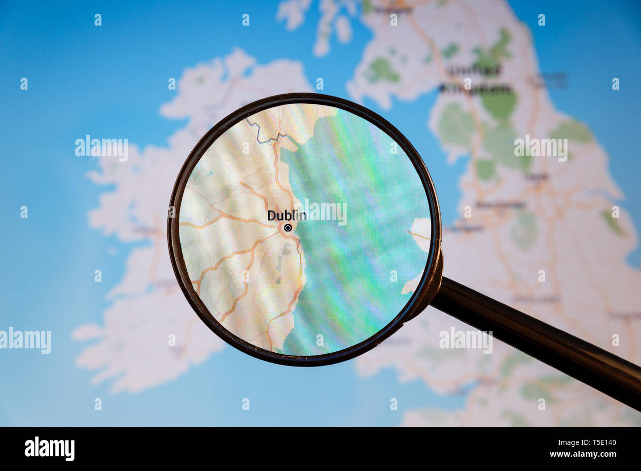 Dublin, Ireland. Political map. City visualization illustrative concept on display screen through magnifying glass. - Stock Image