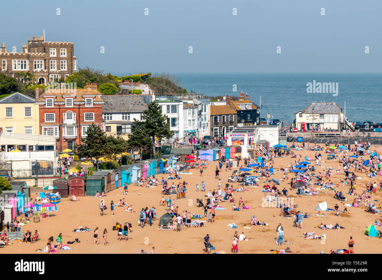People enjoying the sun on the beach at Viking Bay, Broadstairs, during an unusually warm April 2019 Easter Monday Bank Holiday. Stock Photo