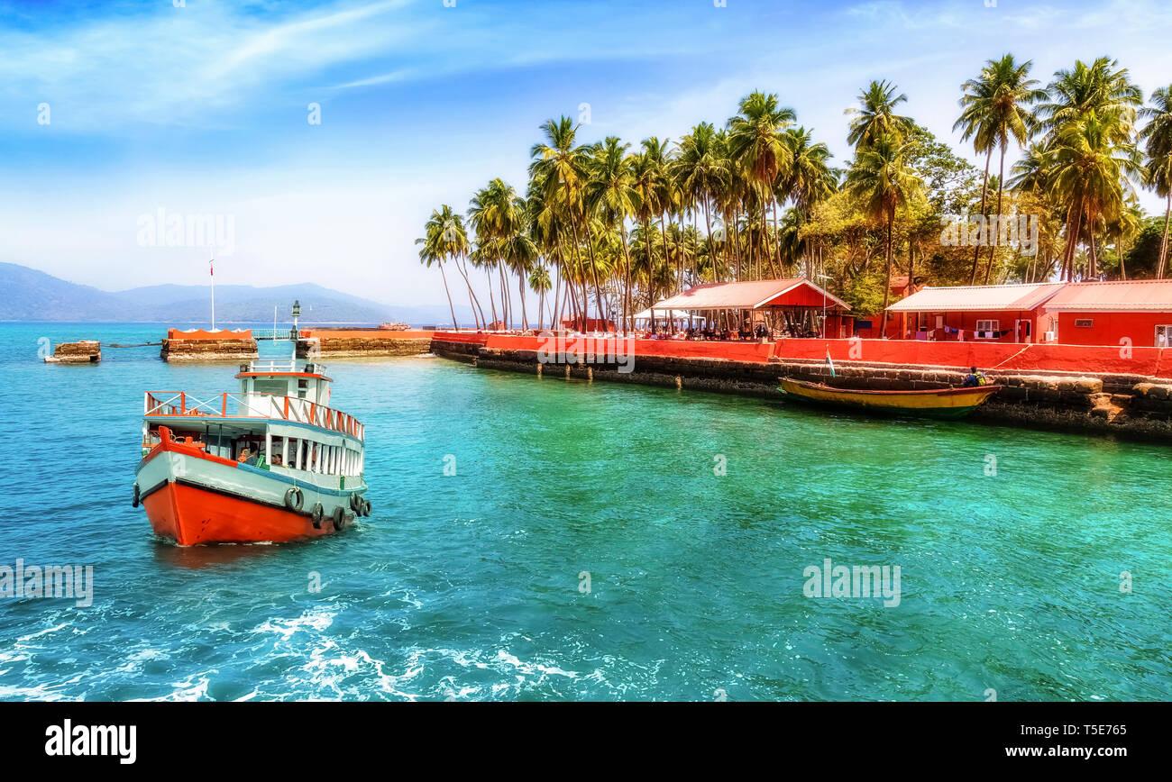 Tourist boat near Ross island beach Andaman India with scenic landscape - Stock Image