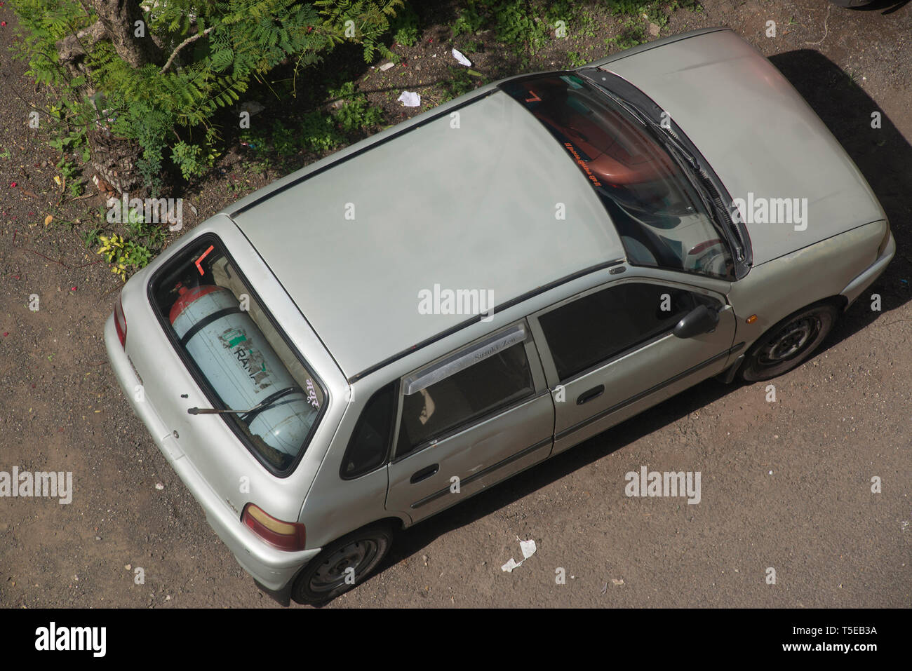 car with Tank of Gas fixed in backside, Pune, Maharashtra, India, Asia - Stock Image