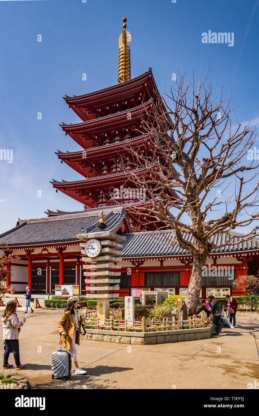 25 March 2019: Tokyo, Japan - The Five-Storey Pagoda and clocktower at Senso-ji Buddhist Temple, Tokyo. Stock Photo