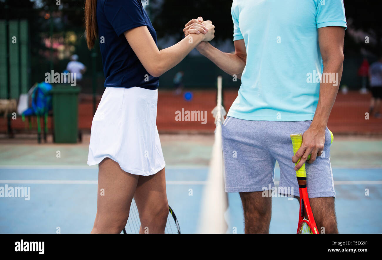 Group of tennis player handshaking after playing a tennis match. Fairplay, sport concept. - Stock Image
