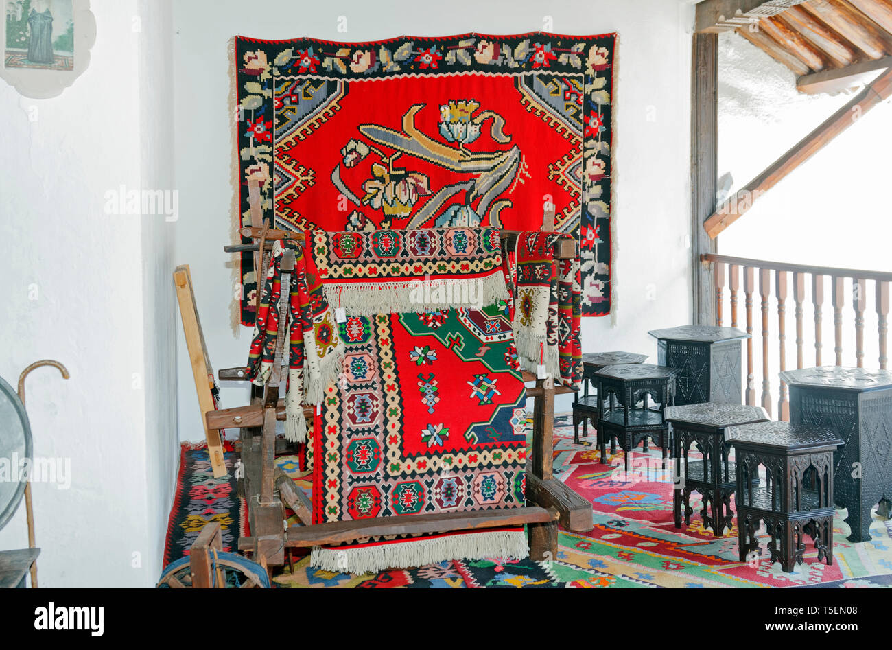 outdoor balcony room; Muslibegovic House; Ottoman period architecture; old; bright colored carpets, National Monument; Mostar; Bosnia Herzegovina; Eur - Stock Image