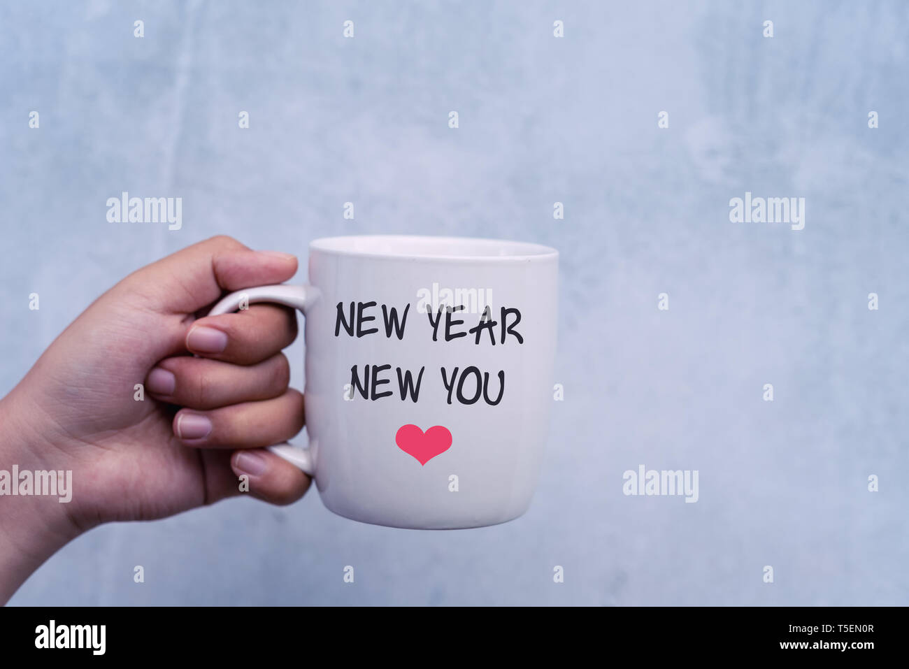 inspirational quotes new year new you text on coffee mug stock