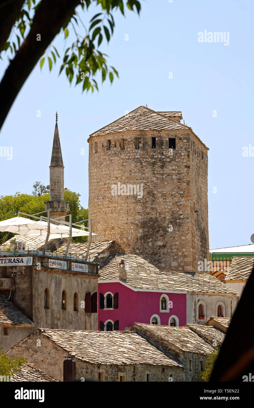 old stone Tara Tower; houses, Museum of the Old Bridge; UNESCO site, Mostar; Bosnia Herzegovina; Europe; summer, vertical - Stock Image
