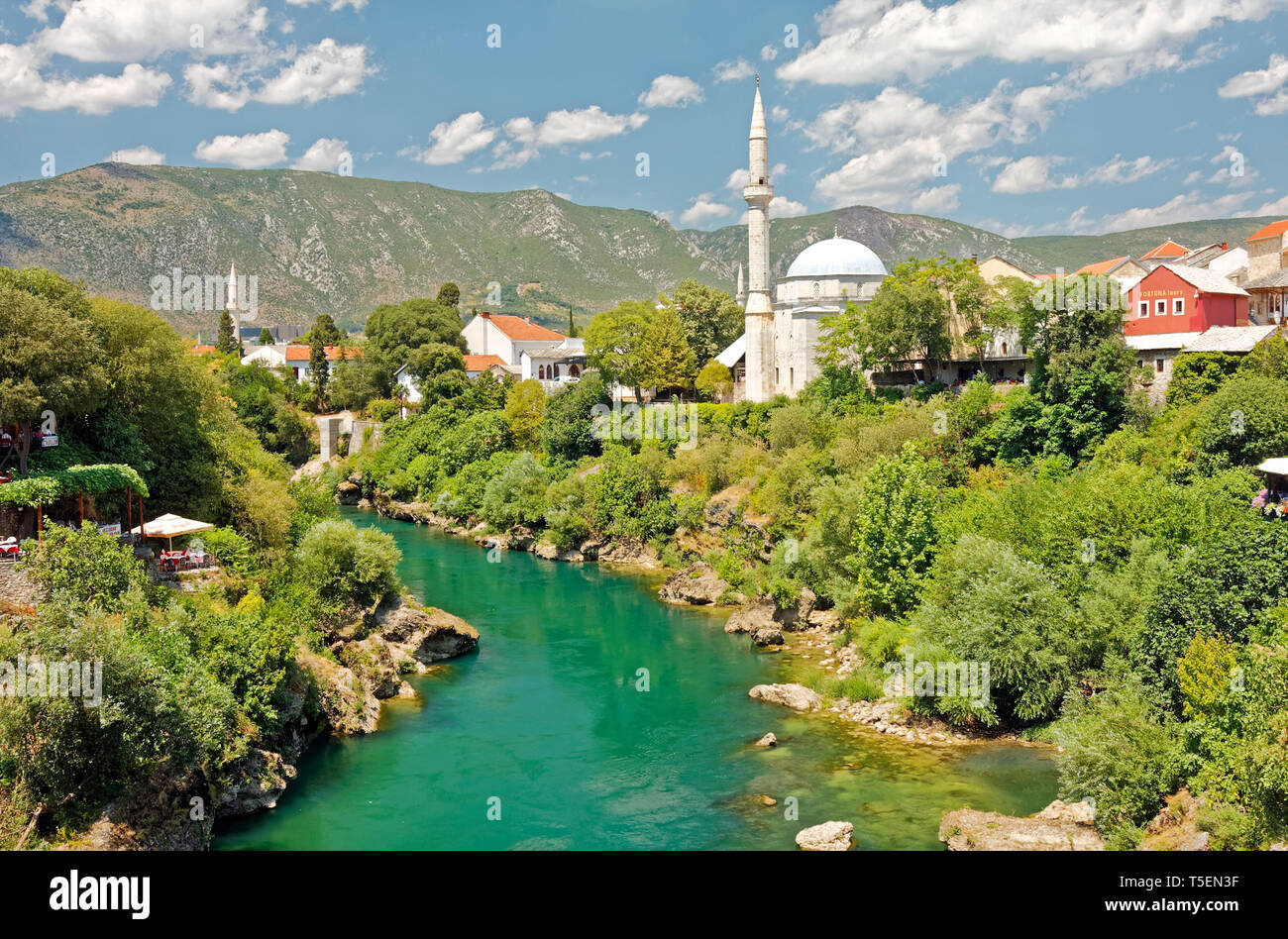 Neretva River overview; buildings, mosques, hillside, water, Mostar; Bosnia Herzegovina; Europe; summer, horizontal - Stock Image