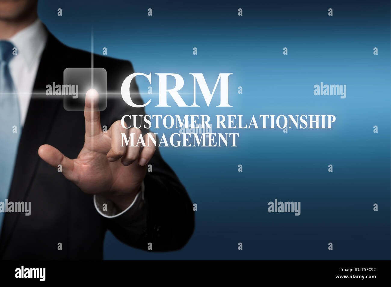 business concept - businessman presses virtual touch screen button - CRM Customer Relationship Management - Stock Image