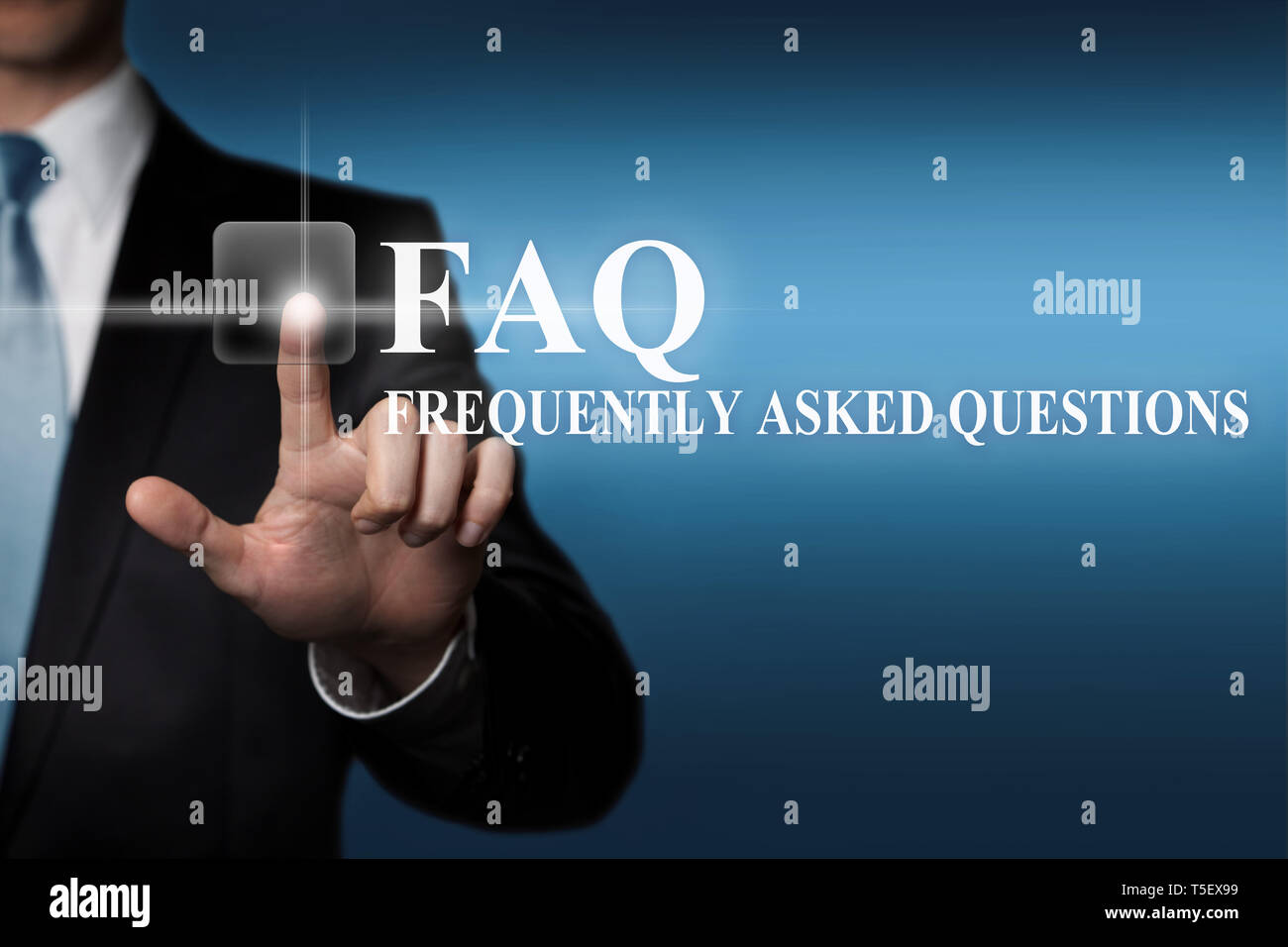 businessman presses virtual touch screen button - FAQ Frequently Asked Questions Stock Photo