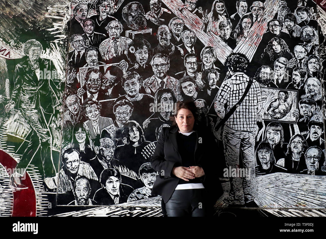 Chief executive Shan Edwards is surrounded by a large scale work by printmaker Thomas Kilpper titled 'The Politics of Heritage' which is carved directly into the rubber floor of the gallery and covers the wall and ceiling. - Stock Image