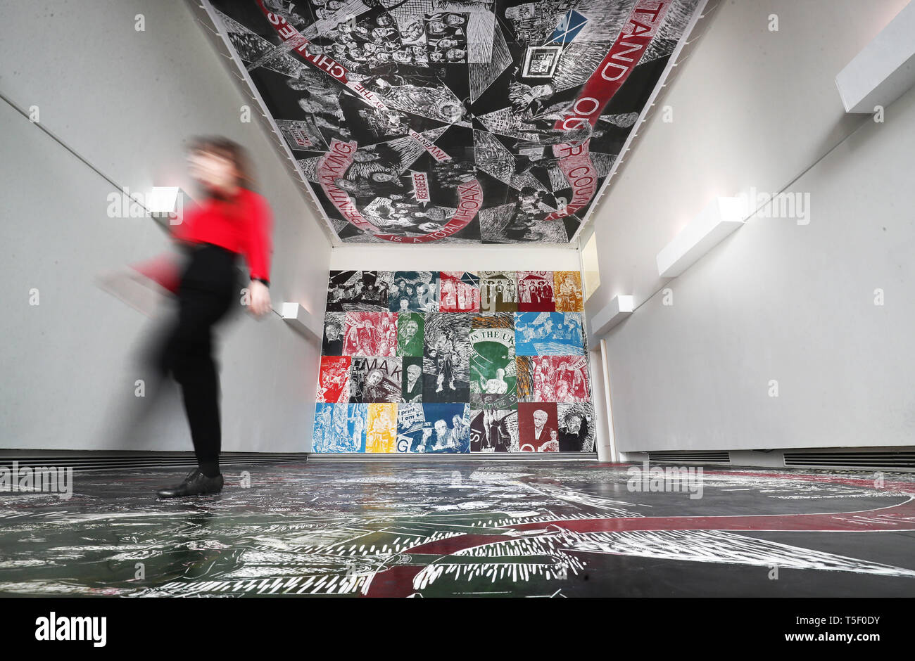 A large scale work by printmaker Thomas Kilpper titled 'The Politics of Heritage' which is carved directly into the rubber floor of the gallery and covers the wall and ceiling is one of several new installations that have been commissioned to feature in the opening exhibition at the new Edinburgh Printmakers at Castle Mills, Edinburgh. - Stock Image