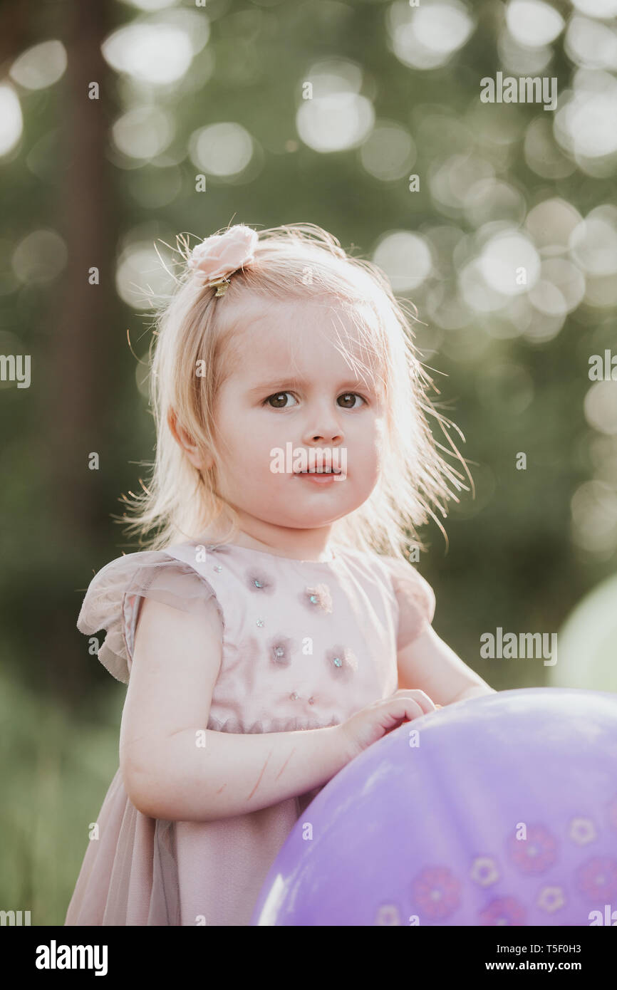 Stylish Baby Girl 2 5 Year Old Holding Big Balloon Wearing Trendy Pink Dress In Meadow Playful Birthday Party Little With A The Par