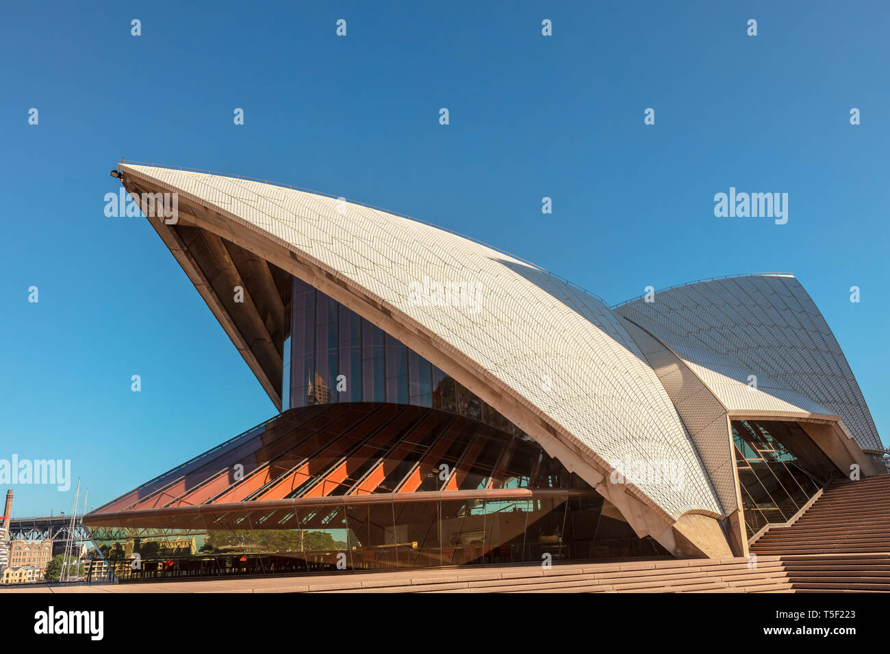 The Sydney Opera House at Sydney Harbour is one of the 20th century's most famous and distinctive buildings. - Stock Image