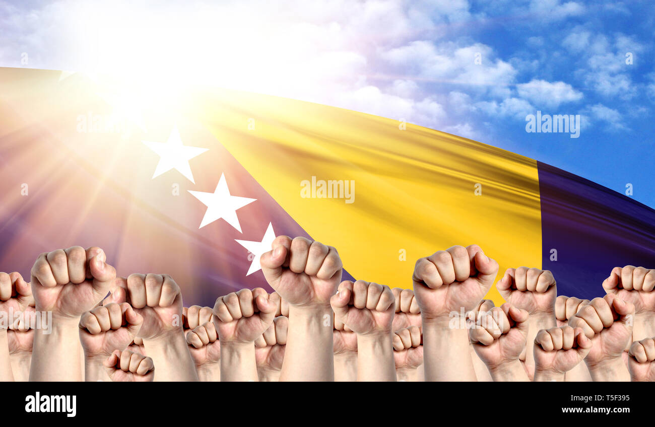 Labor Day concept with fists of men against the background of the flag of Bosnia and Herzegovina - Stock Image