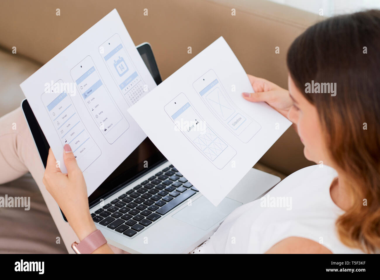 Woman checking sample of mobile interface - Stock Image