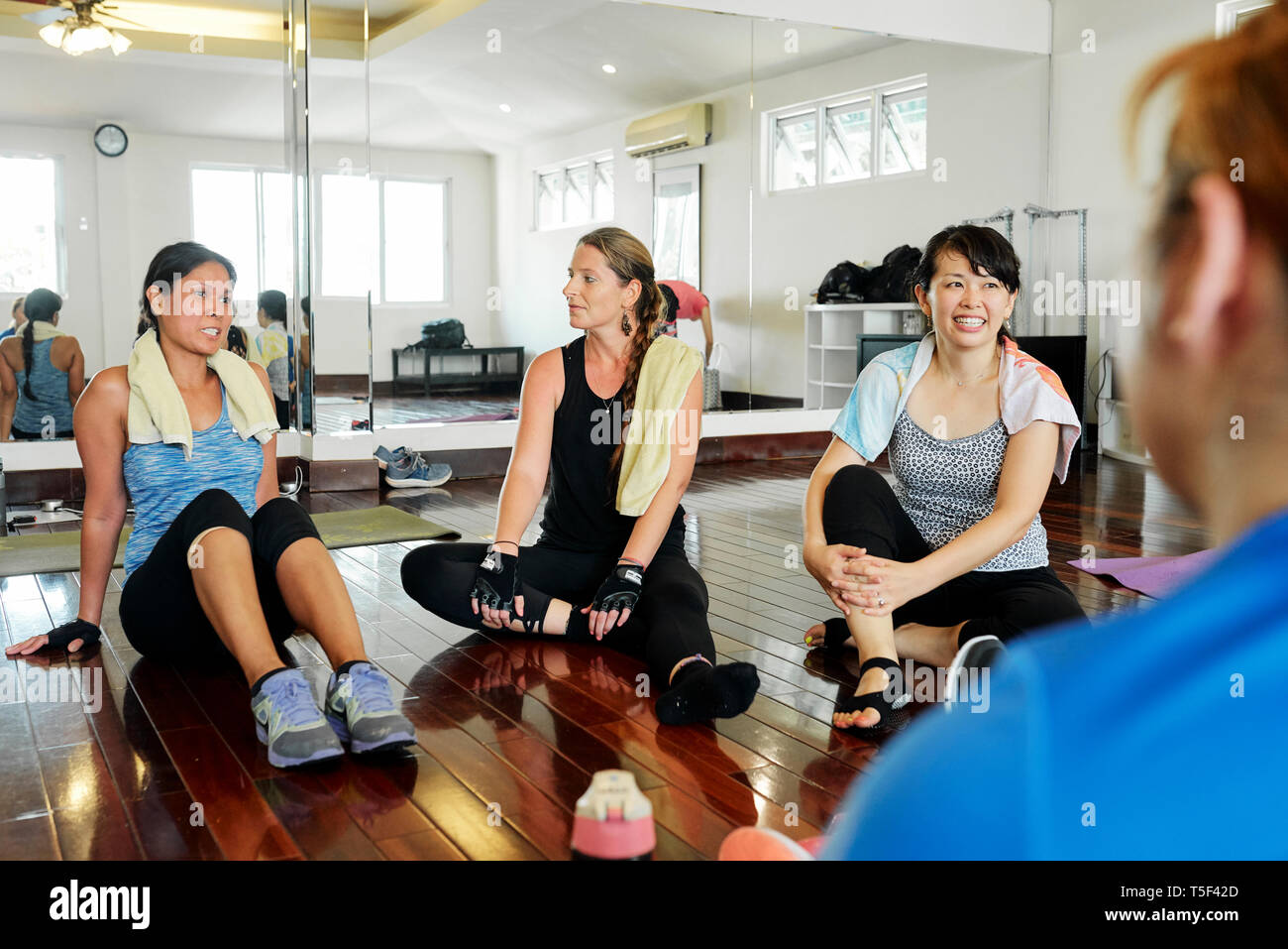 Fitness trainer sharing secrets - Stock Image