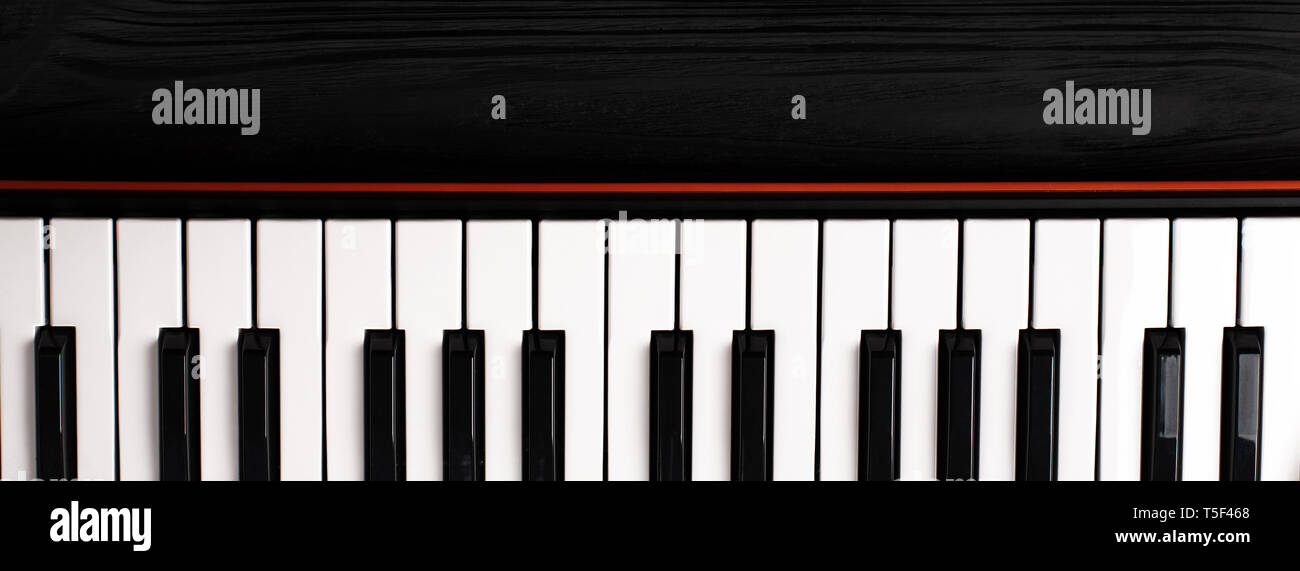 synthesizer keyboard on black wooden background with empty space for text. - Stock Image