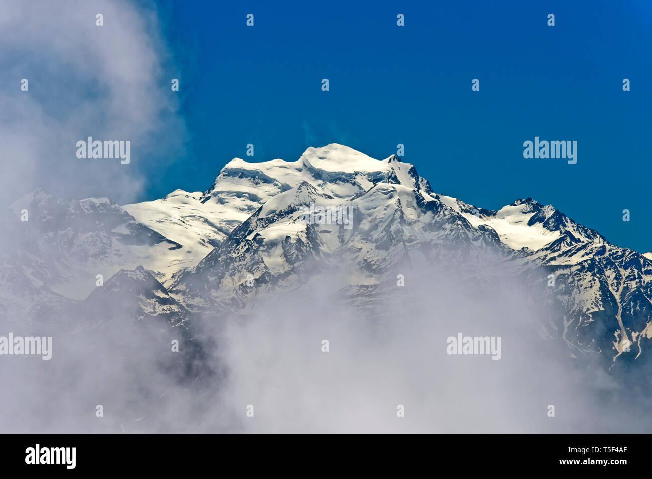 Cloud veil the Grand Combin massif, Pennine Alps, Bourg-Saint-Pierre, Valais, Switzerland - Stock Image