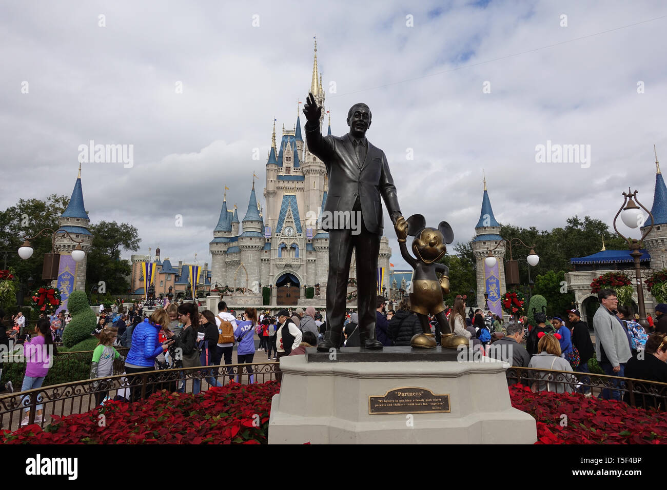 Orlando, FL/USA - 12/10/18: Front horizonal view of Walt Disney and Mickey Mouse Partners statue in front of Cinderellas Castle  at Disney World in Or - Stock Image