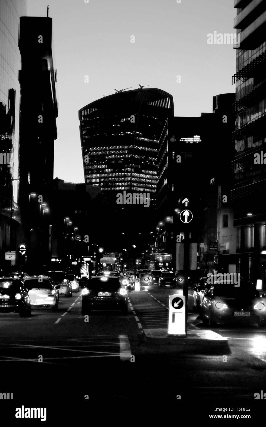 The RBS bank to the left and the 20 Fenchurch Street skyscraper in the background of the Whitechapel Road during the evening in London. - Stock Image
