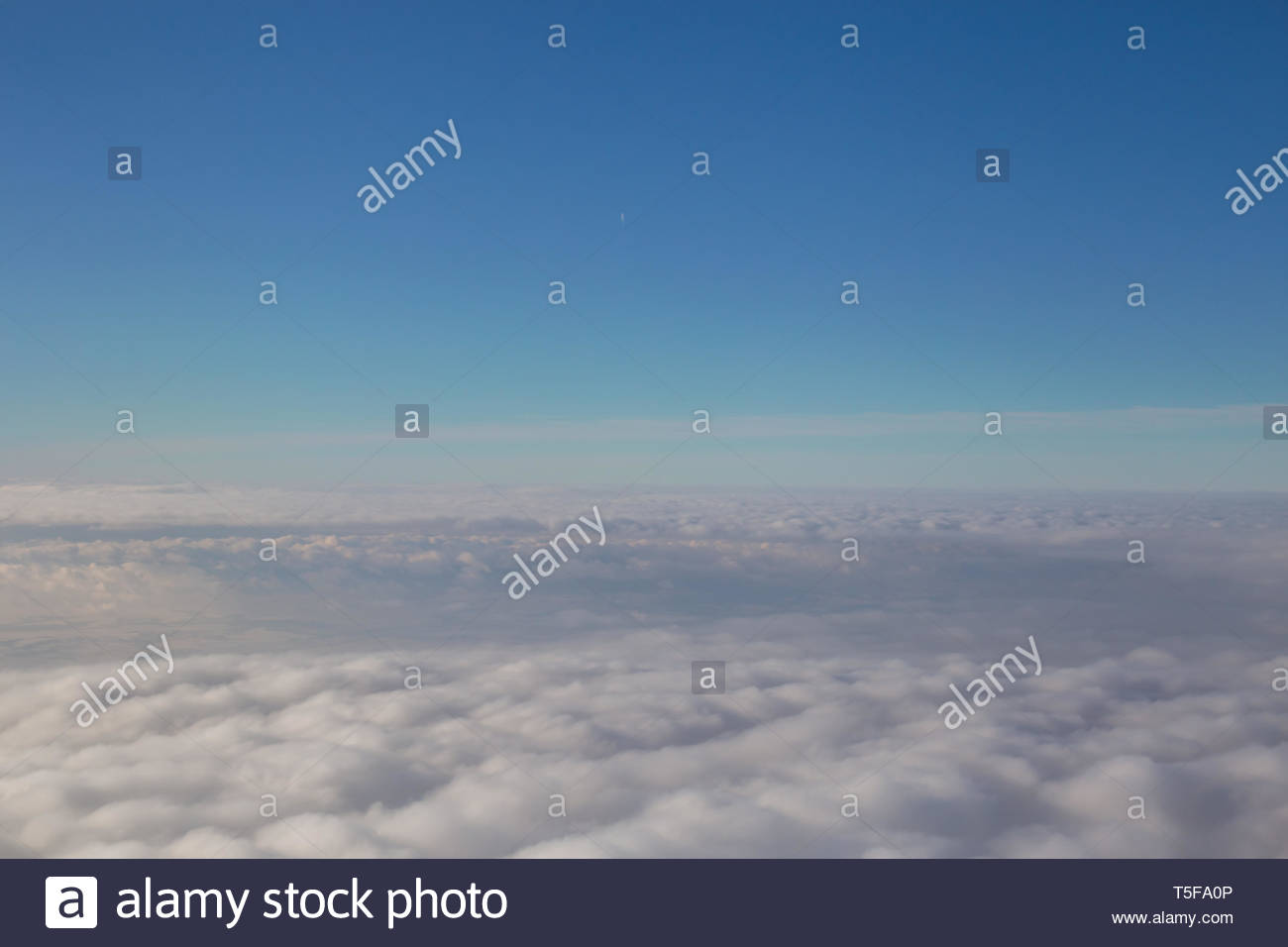 Big Blue Sky and Puffy Clouds - Stock Image