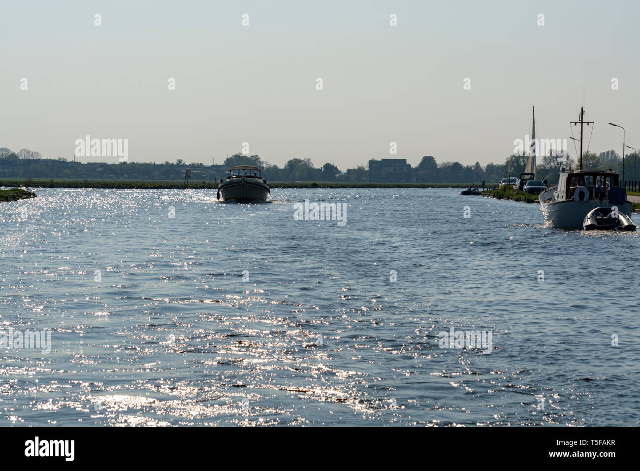 Landscape with waterways and canals of North Holland with boats, canal-side lifestyle in The Netherlands Stock Photo