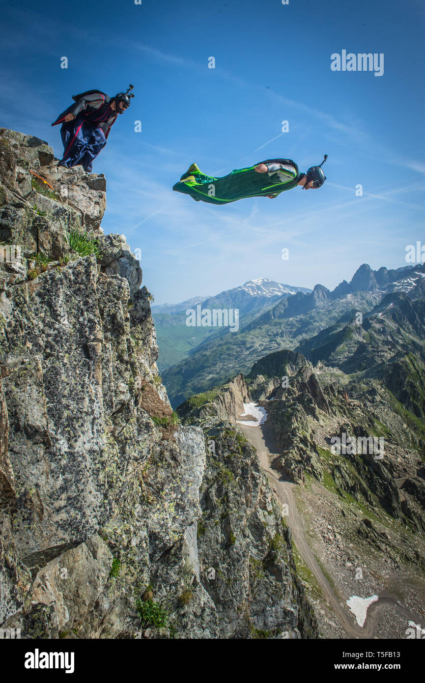 CHAMONIX, FRANCE - JULY 04: Two wingsuit jumper jumping from a cliff in france, Auvergne-rhône-alpes, Chamonix, France on July 4, 2015 in Chamonix, France. (Photo by Fred Marie/Art in All of Us/Corbis via Getty Images) - Stock Image