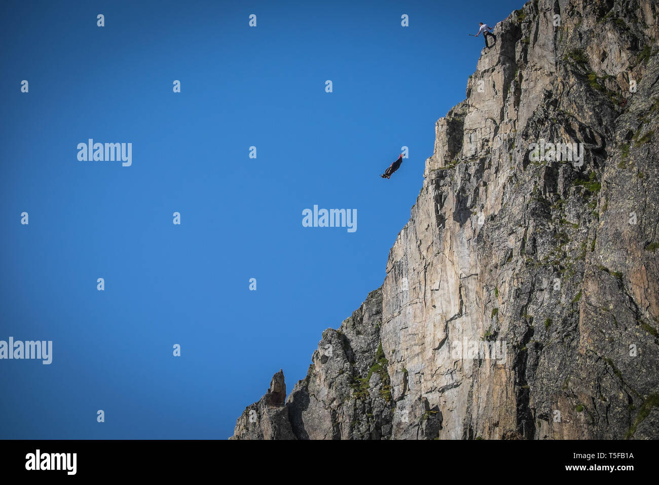 CHAMONIX, FRANCE - JULY 05: A wingsuit jumper jumping from a cliff in brevent, Auvergne-rhône-alpes, Chamonix, France  on July 5, 2015 in Chamonix, France. (Photo by Fred Marie/Art in All of Us/Corbis via Getty Images) - Stock Image
