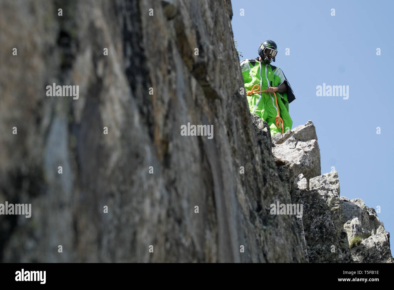 CHAMONIX, FRANCE - JULY 05: A wingsuit jumper jumping from a cliff in france, Auvergne-rhône-alpes, Chamonix, France on July 5, 2015 in Chamonix, France. (Photo by Fred Marie/Art in All of Us/Corbis via Getty Images) - Stock Image