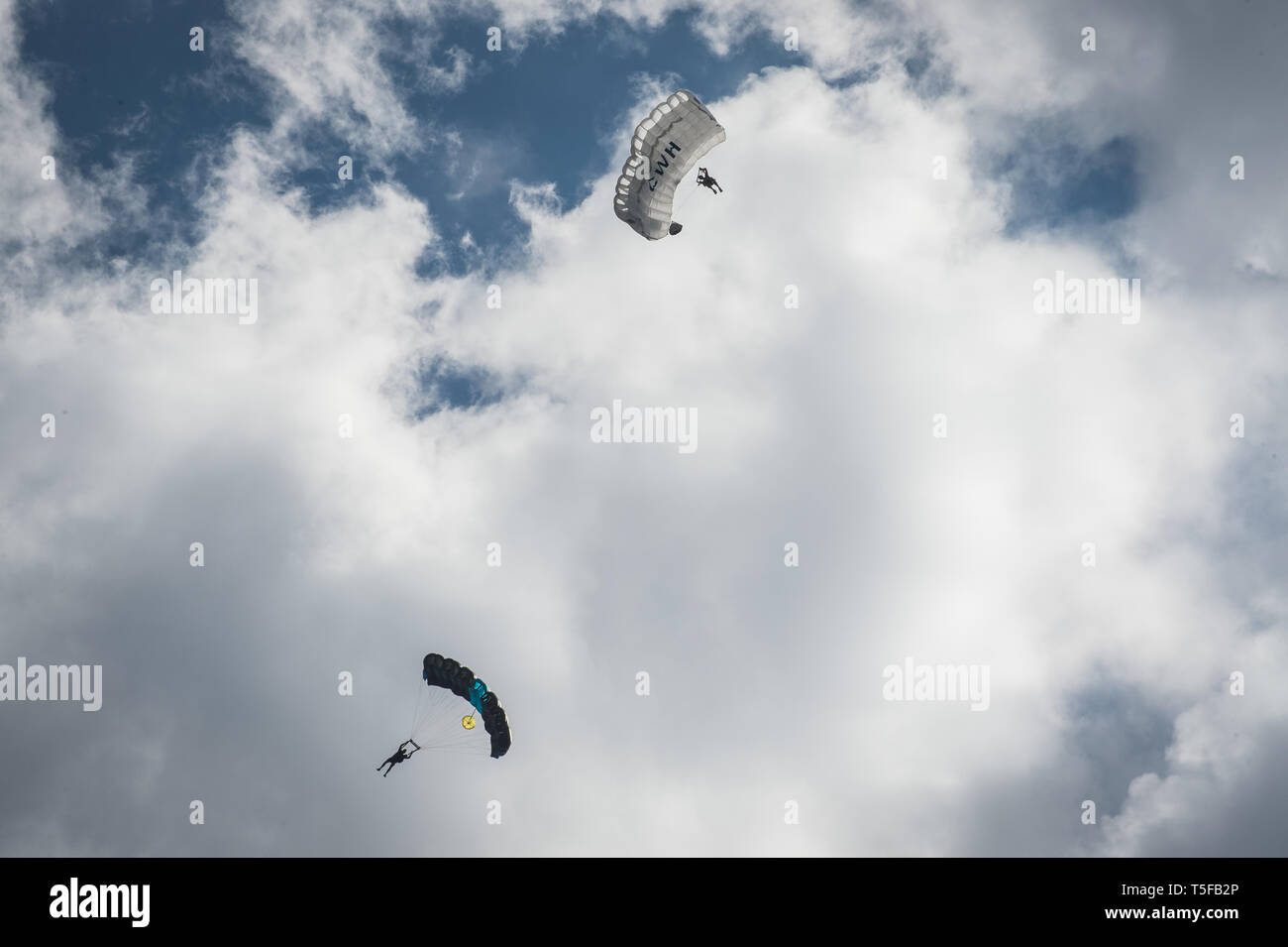 CHORANCHE, FRANCE - AUGUST 22: Two people with a parachute jumping from a cliff in france, Auvergne-rhône-alpes, Choranche, France on August 22, 2015 in Choranche, France. (Photo by Fred Marie/Art in All of Us/Corbis via Getty Images) Stock Photo