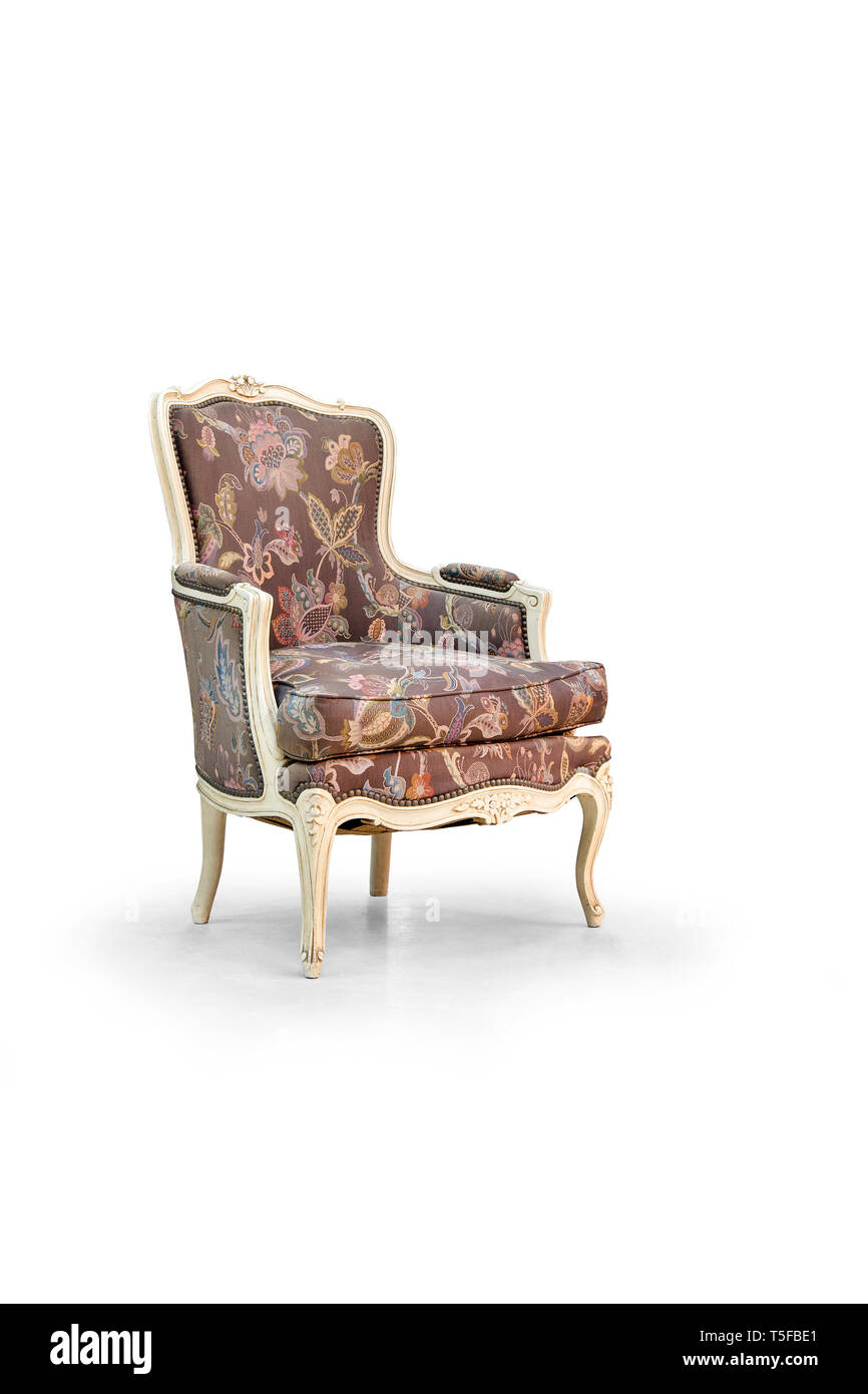 Vintage arm chair on the white background - Stock Image