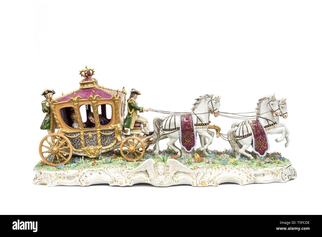 porcelain figurines of horse carriage on white background (with clipping path). Stock Photo