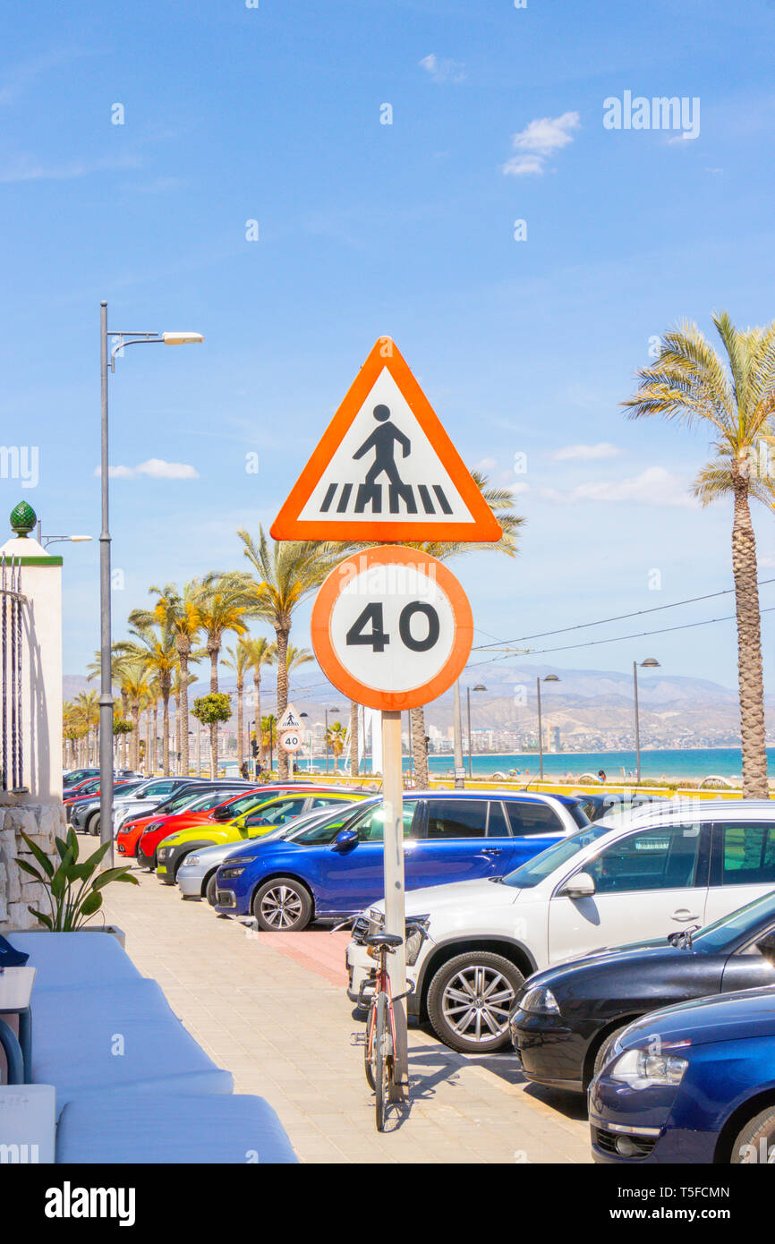 speed limit and pedestrian crossing signs by the beach in Alicante spain - Stock Image