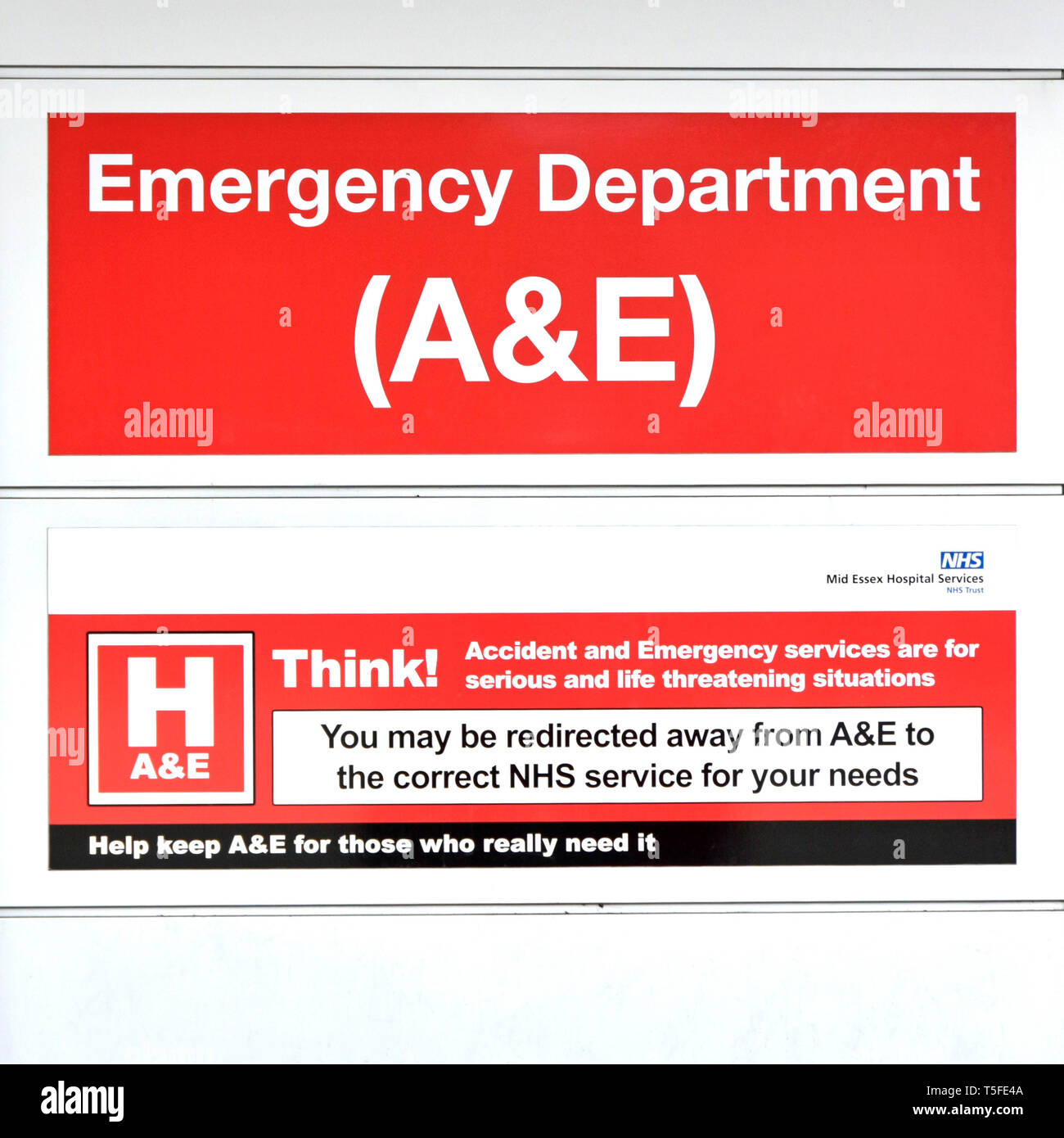 Sign on exterior wall of NHS hospital building entrance to A&E emergency healthcare department serious & life threatening situations London England UK - Stock Image