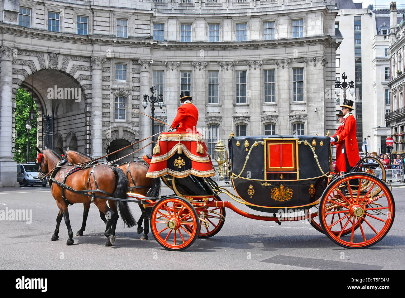 Horse drawn State Landau carriage move towards  Admiralty Arch with coachman & footman in uniform after transporting diplomatic dignitaries London UK - Stock Image