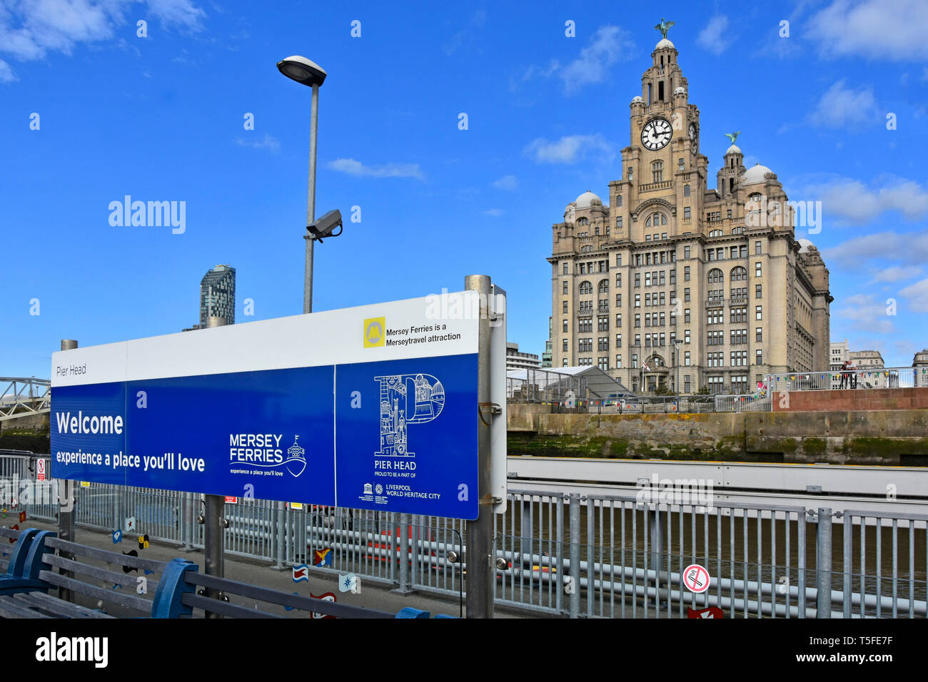 River Mersey Ferry Pier Head waterfront passenger landing stage welcome sign  The Royal Liver Building beyond City of Liverpool Merseyside England UK - Stock Image