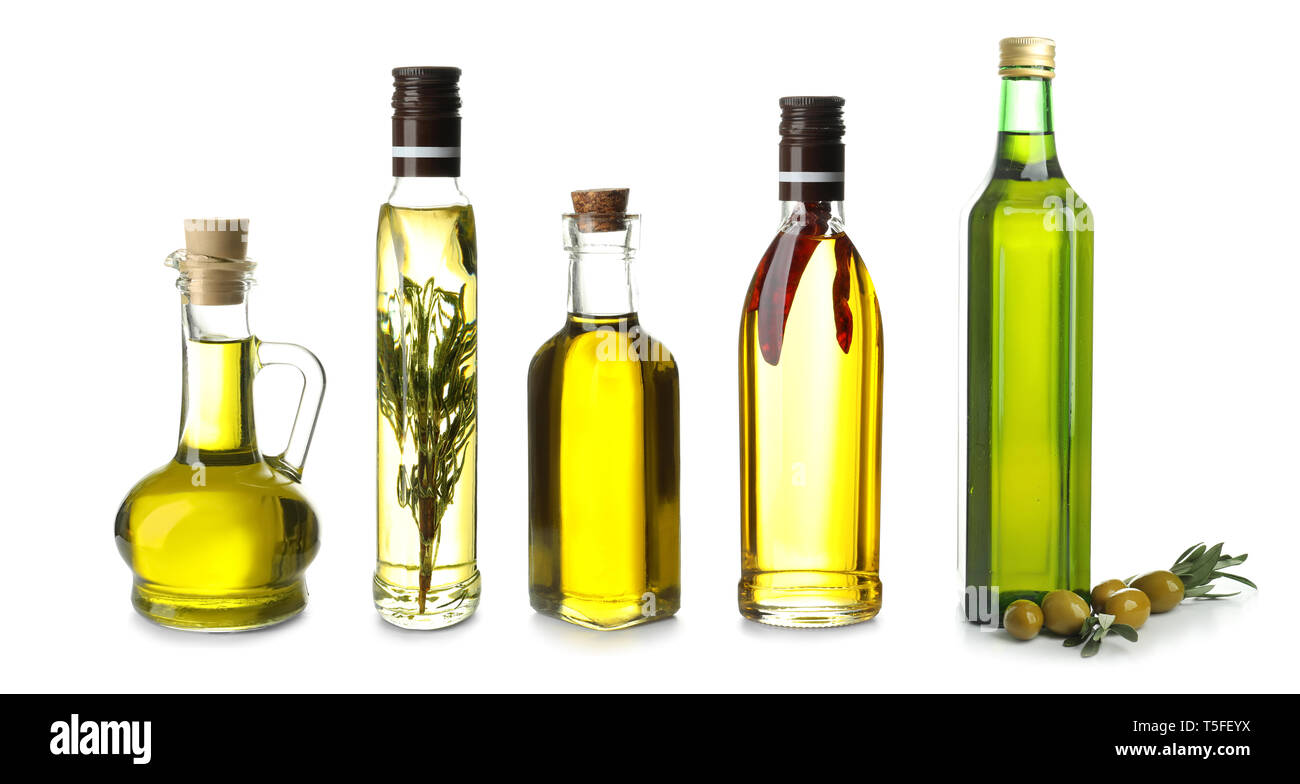 Different Bottles With Olive Oil On White Background Stock