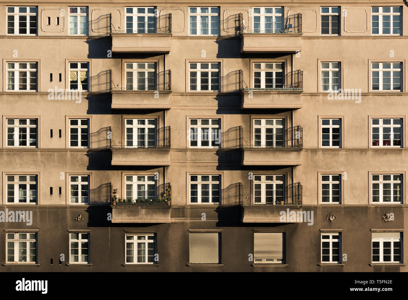 Eight old balconies in the light of the sunset - Stock Image
