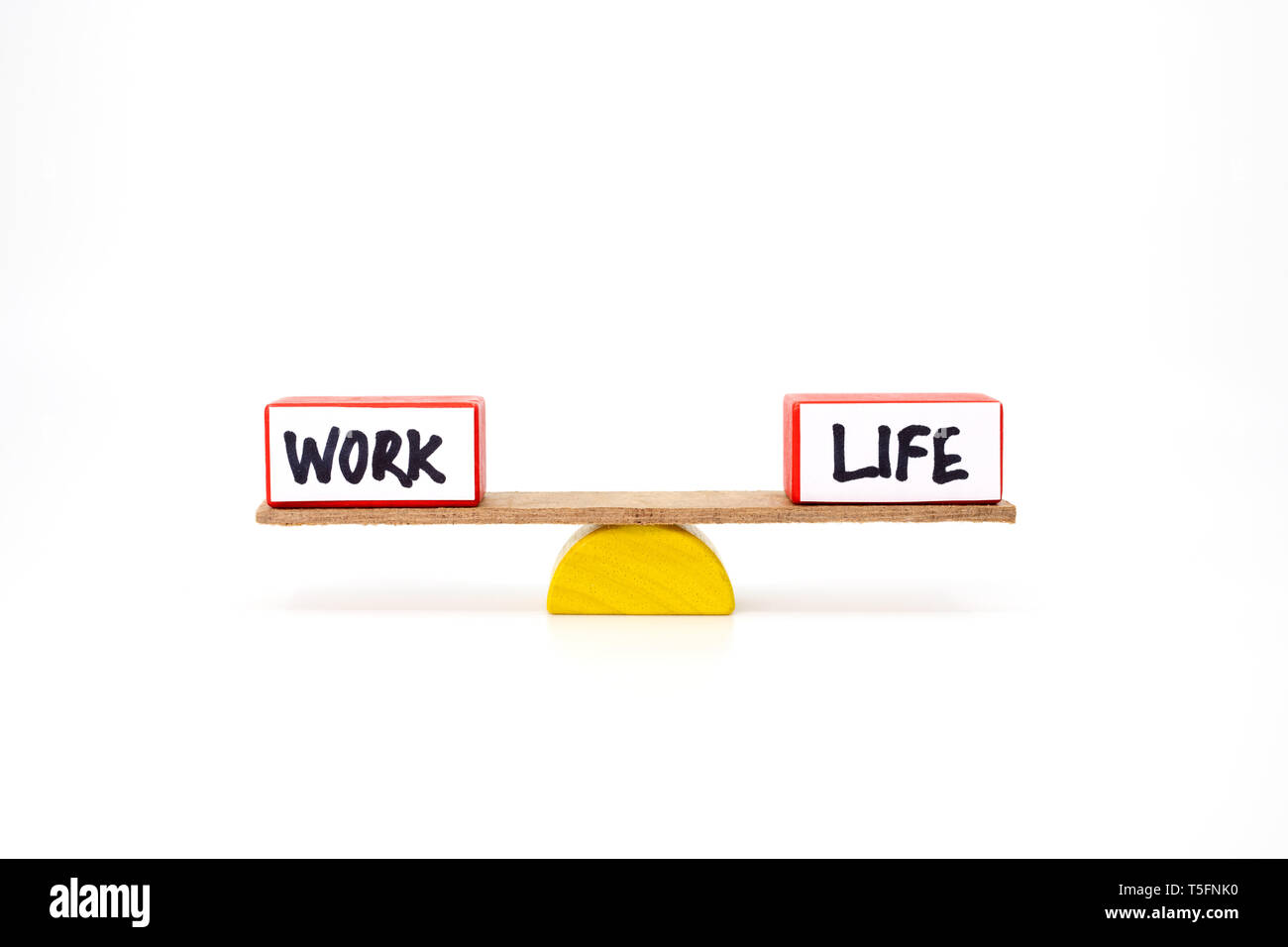 Work life balance concept with two blocks representing work and life - Stock Image